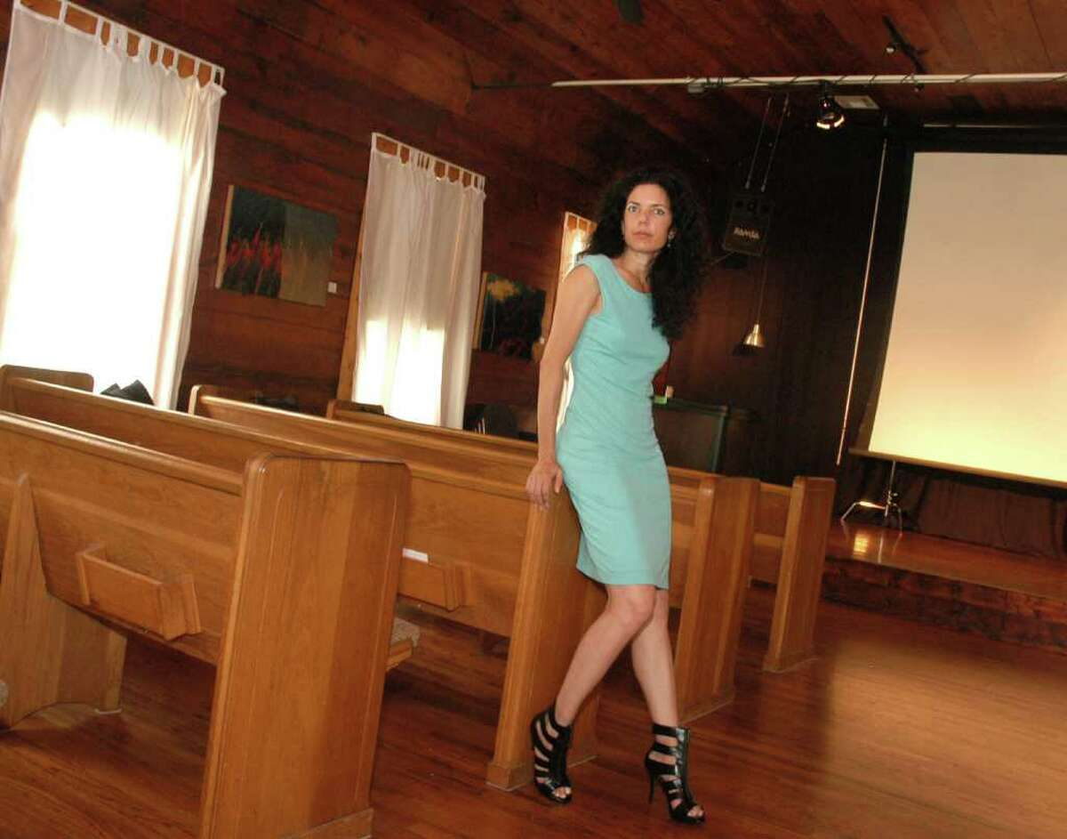 Owner/founder, and resident Cressandra Thibodeaux inside 14 Pews in The Heights.