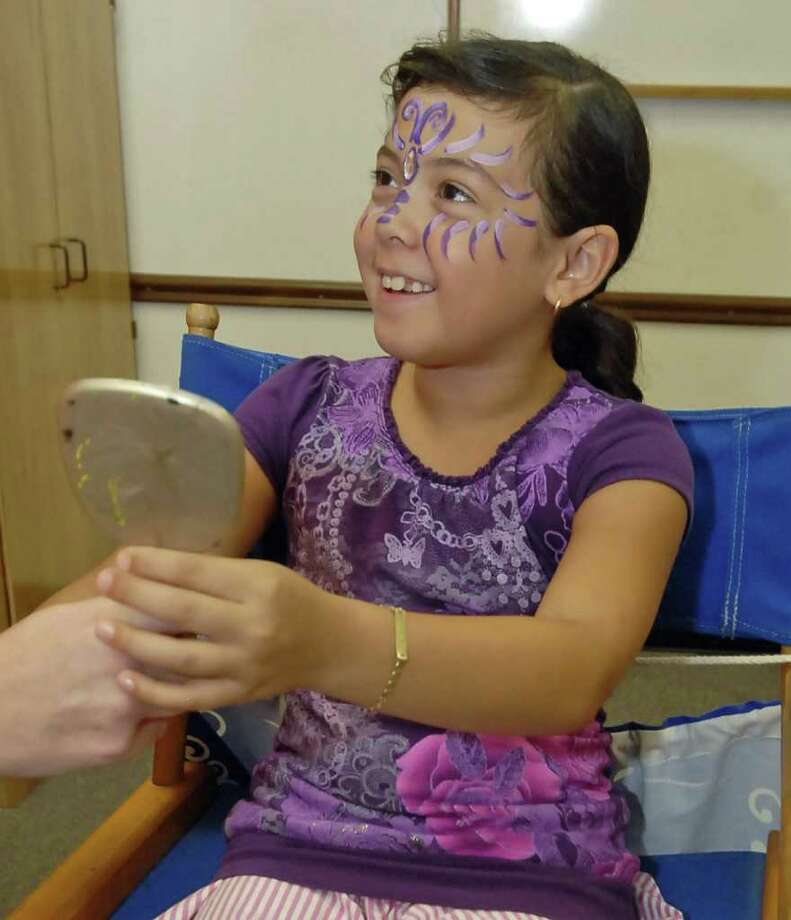 Nine-year-old Lee Elementary student Paula Rojas wanted to be painted as a butterfly rather than a zombie during a zombie face painting activity held by Jennifer Loera at Fairbanks Branch Library Monday 7/11/11. Photo by Tony Bullard. Photo: Tony Bullard / Credit: for the Chronicle