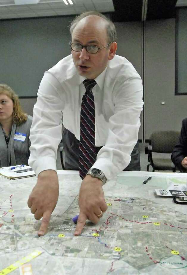 Jersey Village City Manager Mike Castro discusses future development along a section of a watershed map of Greens Bayou during a Greens Bayou Corridor Coalition public meeting held at Lone Star College University Park 2/16/11. Photo by Tony Bullard. Photo: Tony Bullard / Freelance Credit: Tony Bullard