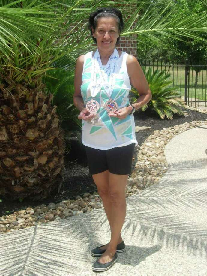 FLEET FOOTED: Delores Henry, 60, earned bronze medals in the 5K and 10K running races at the National Senior Games. Photo: Courtesy