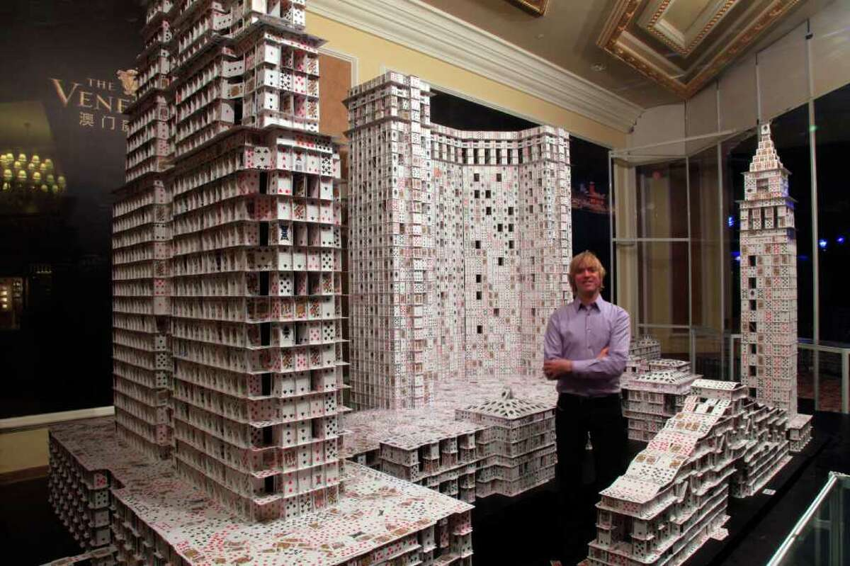 Some might consider building houses of cards to be child's play, but record-holding cardstacker Bryan Berg literally takes the hobby to another level. His towering card sculptures are the result of meticulous planning and engineering -- Berg uses no tape, glue, folding, or other structural aids in his impressive creations. During Chinese New Year of 2010, Berg was commissioned to break his own record at The Venetian Macao Resort Hotel, the largest casino in the world. The project took 44 days, 219,000 cards (4,000 decks), and set a new Guinness World Record. Read on to see more of his incredible works, and to find out exactly how they're built. Even more photos and information are available at his website, Cardstacker.