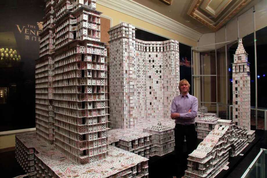 Some might consider building houses of cards to be child's play, but  record-holding cardstacker Bryan Berg literally takes the hobby to  another level. His towering card sculptures are the result of meticulous  planning and engineering -- Berg uses no tape, glue, folding, or other  structural aids in his impressive creations. During Chinese New Year of 2010, Berg was commissioned to break his own  record at The Venetian Macao Resort Hotel, the largest casino in the  world. The project took 44 days, 219,000 cards (4,000 decks), and set a  new Guinness World Record. Read  on to see more of his incredible works, and to find out exactly how  they're built. Even more photos and information are available at his  website, Cardstacker. Photo: Bryan Berg/Cardstacker.com