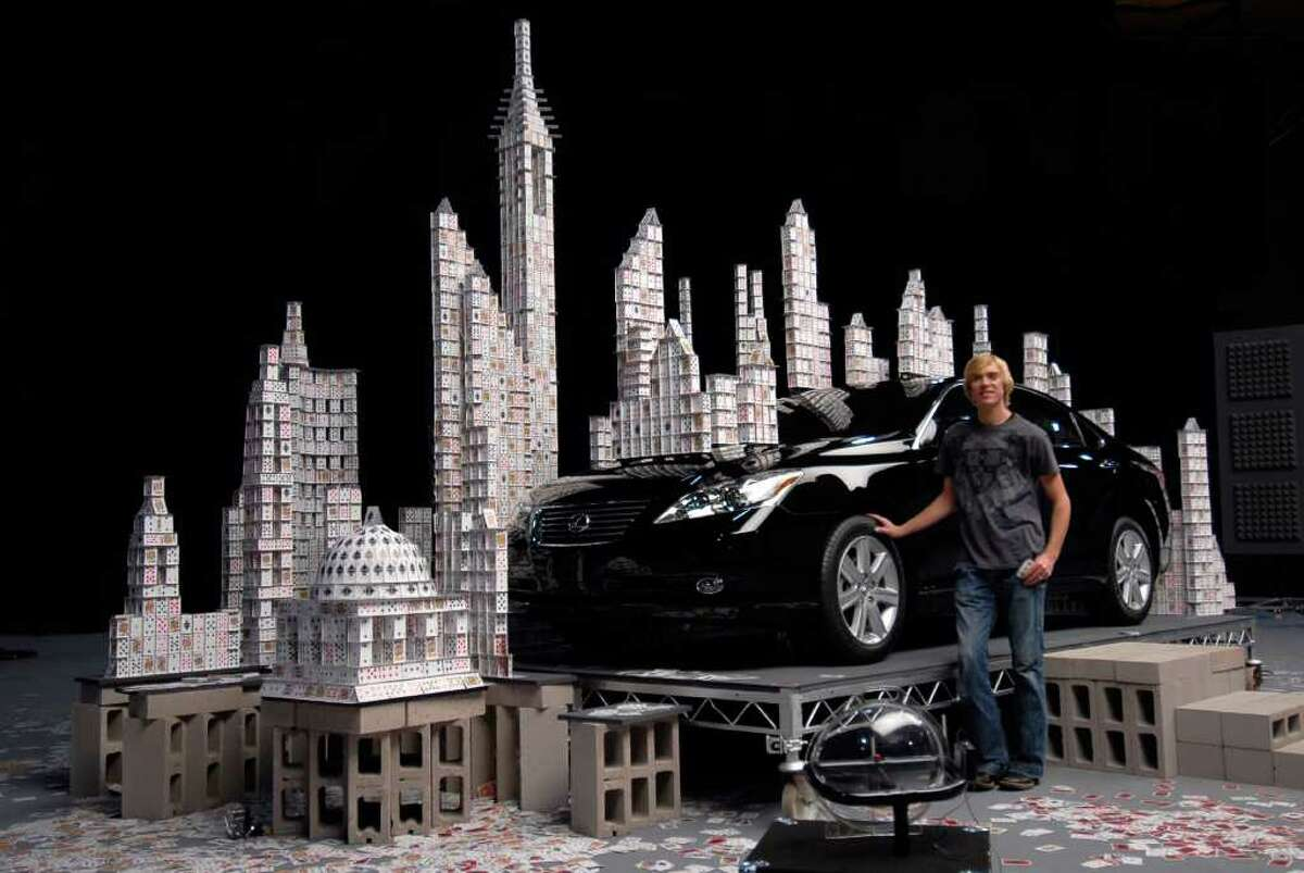 Berg is much more qualified than your average cardstacker -- he holds a Professional Degree in Architecture and a Design Achievement Award from Iowa State University, and a Masters in Design Studies from Harvard. However, all of his stacking techniques were self-developed and taught. Here, he poses in front of a structure commissioned by Lexus for a television commercial to demonstrate the car's smooth engine.
