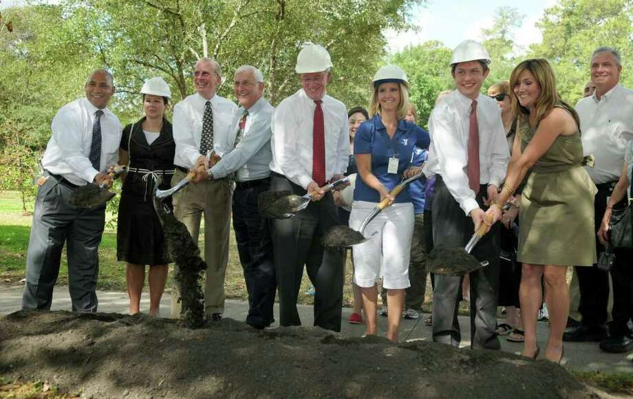 Houston City Council Member Mike Sullivan, center, hosted a groundbreaking ceremony for the new Kingwood Community Center. Freelance photo by Jerry Baker Photo: Jerry Baker, Freelance