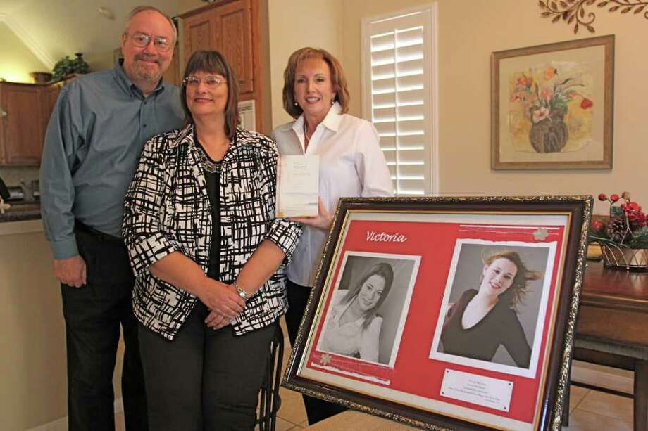 """Brian and Leah Foutz of New Ulm started a ministry after their daughter, Victoria, was murdered in 2004.  Janice Harvins-Hamric (white shirt) wrote a book, """"from misery to ministry, a walk of faith through the loss of a loved one,"""" (no caps on book title) about their journey of hope, healing and renewal..  Suzanne Rehak/Freelance photographer for the Chronicle Photo: Suzanne Rehak, Freelance Photographer"""