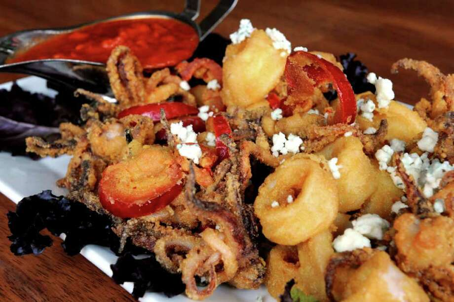 The fried calamari with cherry peppers and marinara at The Lakehouse Bar and Grill on Route 34 in Seymour. Photo: Autumn Driscoll / Connecticut Post