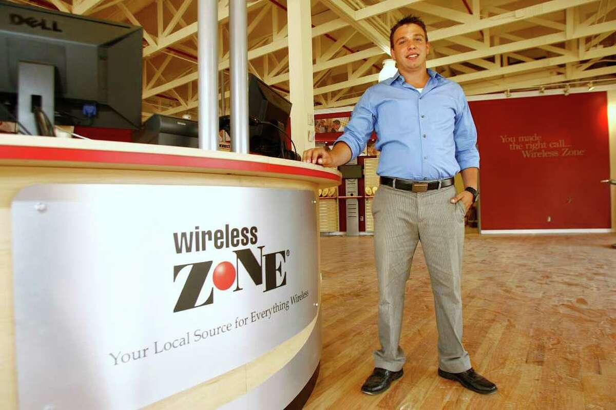 Wireless Zone store manager Dan Saputo, 26, poses for a photograh on Tuesday, July 19, 2011. Saputo says they are shooting for an August 1, 2011 opening of their store on Newtown Road in Danbury.
