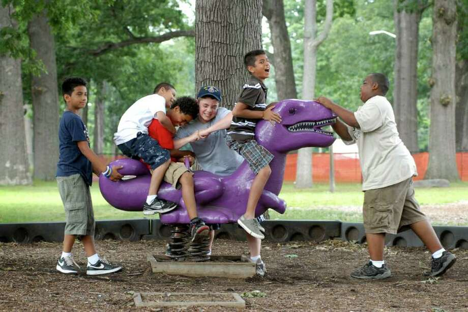 YMCA campers Aurick Rivera, Gary Mendez, Angel Soto, Cole Dorsey, Sam Palma and Kheon Jones play at the Scalzi Park playground in Stamford, Conn. on Tuesday July 19, 2011. Photo: Dru Nadler / Stamford Advocate Freelance