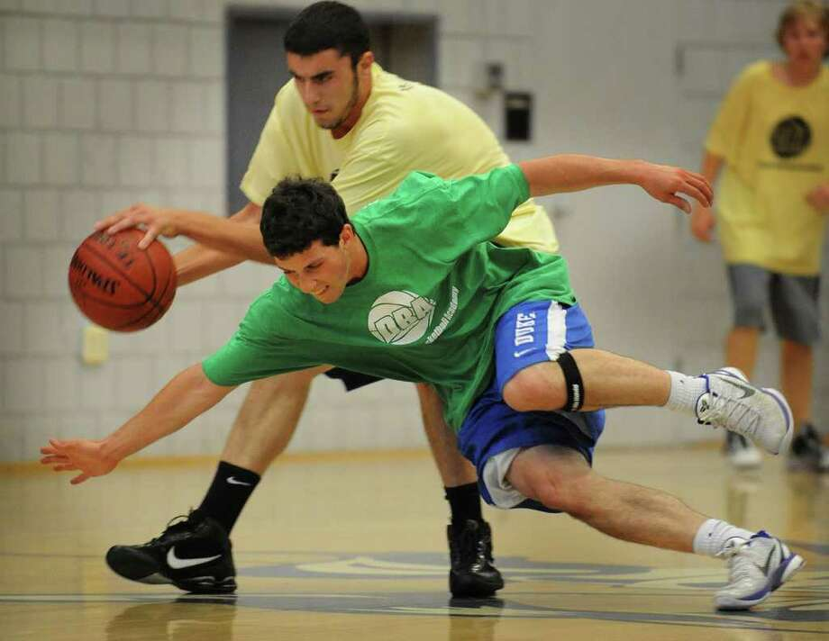 Weston's Matt Smolinsky attempts to make a steal during a summer league matchup with Joel Barlow at Christian Heritage School in Trumbull on Sunday, July 10, 2011. Photo: Brian A. Pounds / Connecticut Post