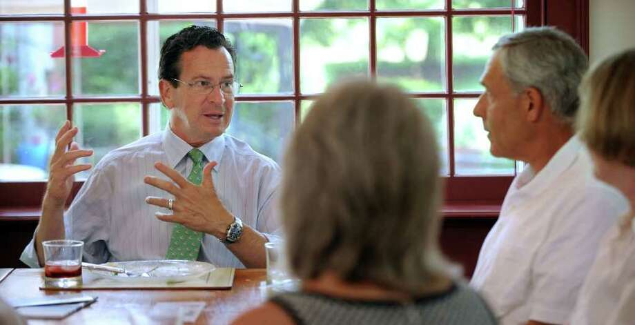 Gov. Dannel Malloy, left, meets with members of the Litchfield Hills Bed and Breakfast Association in Southbury Tuesday. Right is Ed Edelson, president of the organization and owner, along with wife Christine, of Cornucopia at Oldfield Bed and Breakfast in Southbury, where the lunch meeting was held. Photo taken Tuesday, July 19, 2011. Photo: Carol Kaliff