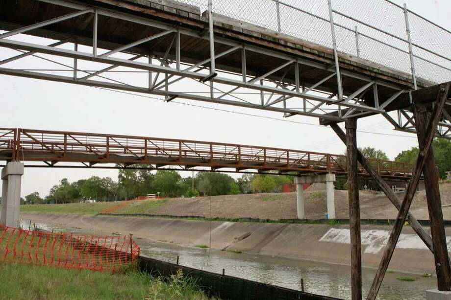 The timber-floored footbridge across Brays Bayou at Atwell Drive is being replaced by a larger modern version of steel and concrete.  Photo by R. Clayton McKee Photo: R. Clayton McKee, Freelance / © R. Clayton McKee