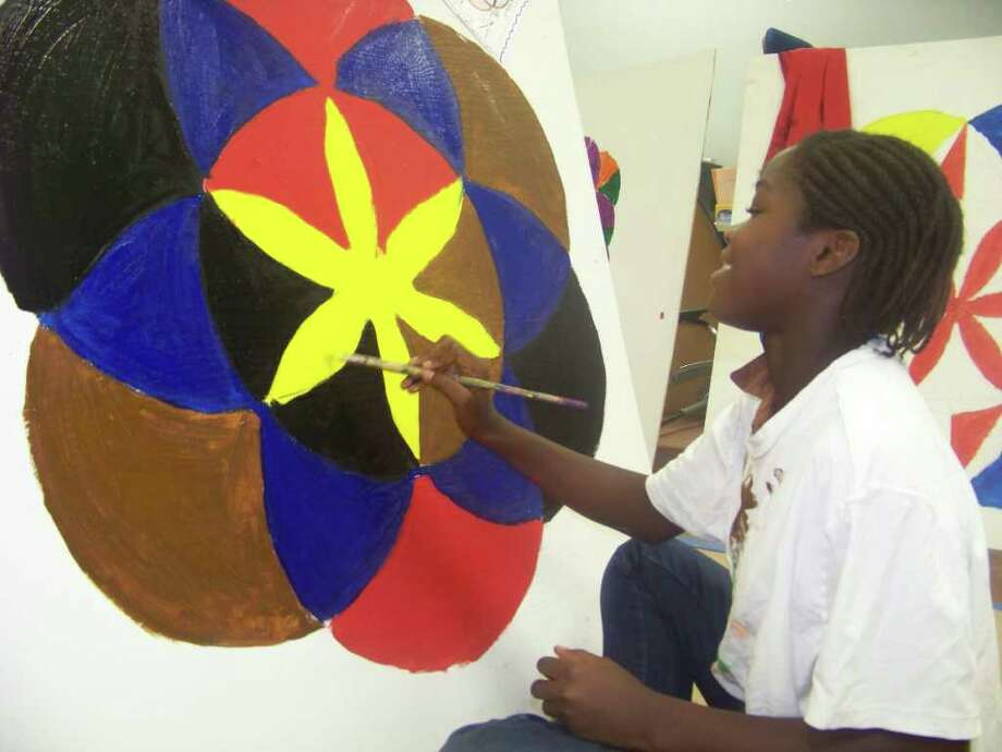 Apolina Irankunda works on an art project at Camp Culture. Photo: Handout Photo
