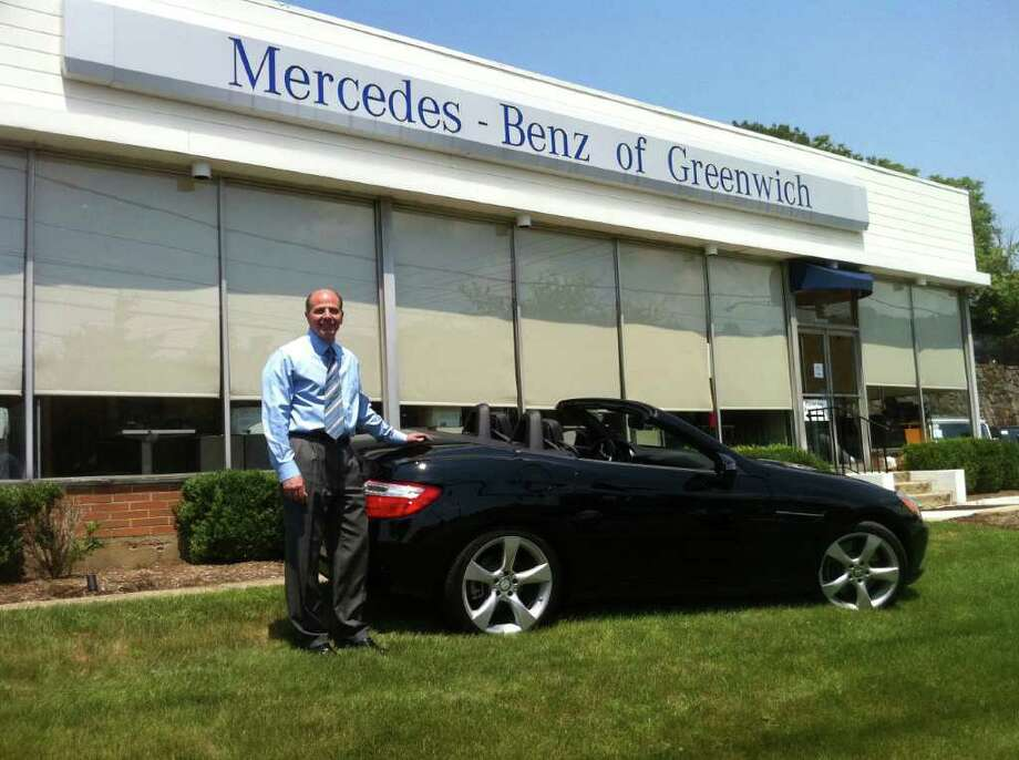 Lou Liodori, general manager of Mercedes-Benz of Greenwich, shows a new SLK convertible at the West Putnam Avenue dealership. Staff Photo/Richard Lee Photo: Contributed Photo