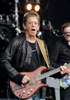 US singer Lou Reed performs on the stage of the 20th edition of the Vielles Charrues Music Festival on July 17, 2011 in Carhaix, Brittany. AFP PHOTO FRED TANNEAU Photo: FRED TANNEAU, AFP/Getty Images / 2011 AFP