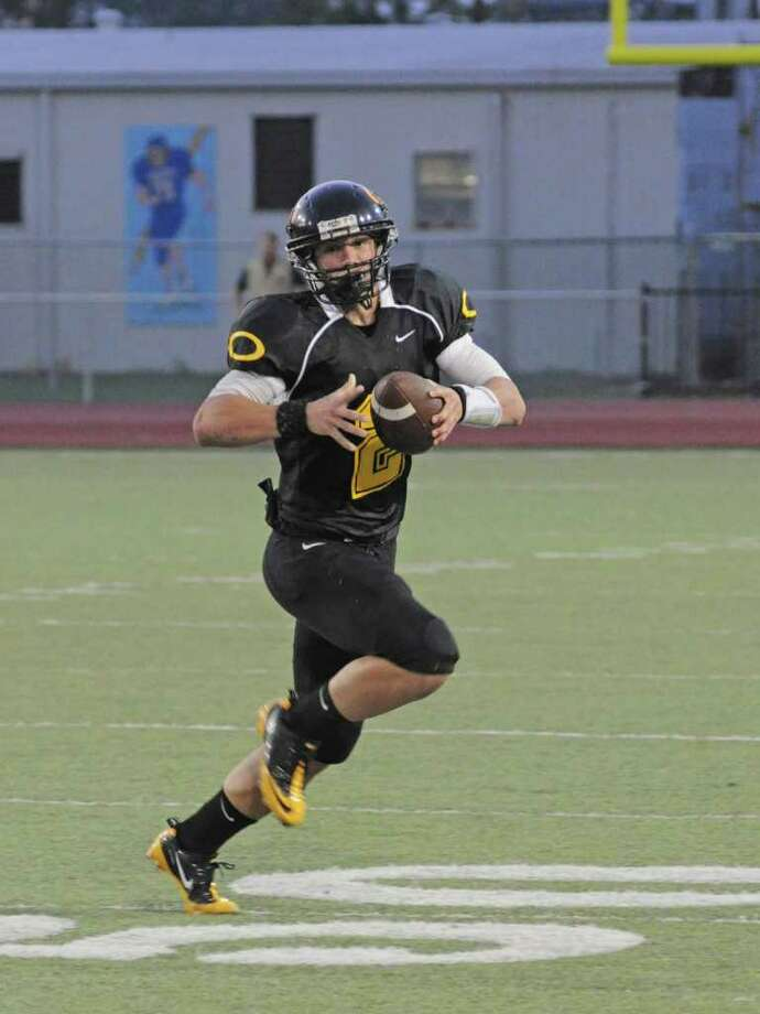 L. SCOTT HAINLINE: FOR THE CHRONICLE SIGNAL CALLER: Klein Oak senior quarterback Nicky Baratti (No. 2 with ball), hopes to lead the Panthers even deeper into the playoffs in 2011. Photo: L. SCOTT HAINLINE / freelance