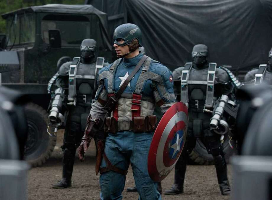 Captain America (Chris Evans, center), surrounded by HYDRA Soldiers in CAPTAIN AMERICA: THE FIRST AVENGER, from Paramount Pictures and Marvel Entertainment. Photo: Photo Credit: Jay Maidment / Mar / © 2011 MVLFFLLC. TM & © 2011 Marvel. All Rights Reserved.