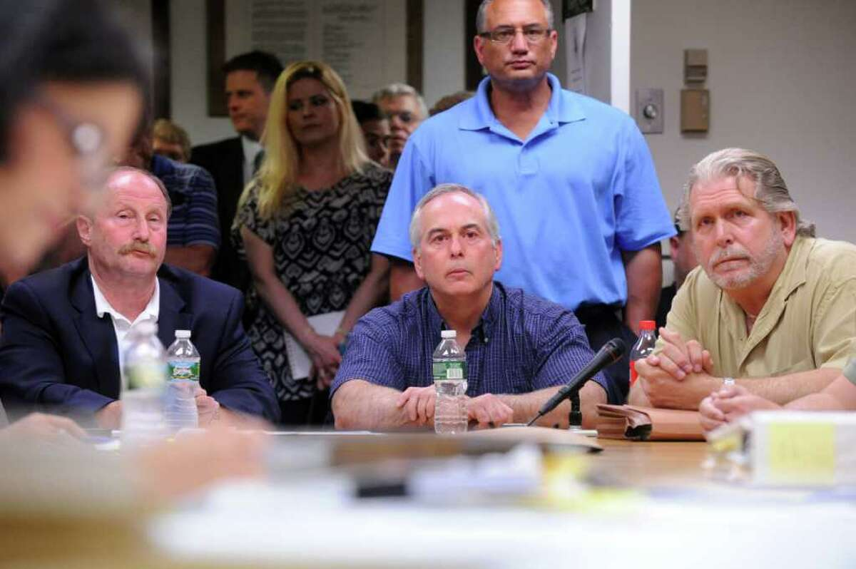 Stamford Police Chief Robert Nivakoff, left, Captain Richard Conklin and Sgt. Peter di Spagna meet with the Board of Finance, to discuss an investigation into the theft of metals from city scrapyards, at the Government Center in Stamford, Conn., July 19, 2011. A crowd of people were turned away from the public meeting when the room met capacity, four fire marshals were on hand to control the overflow.