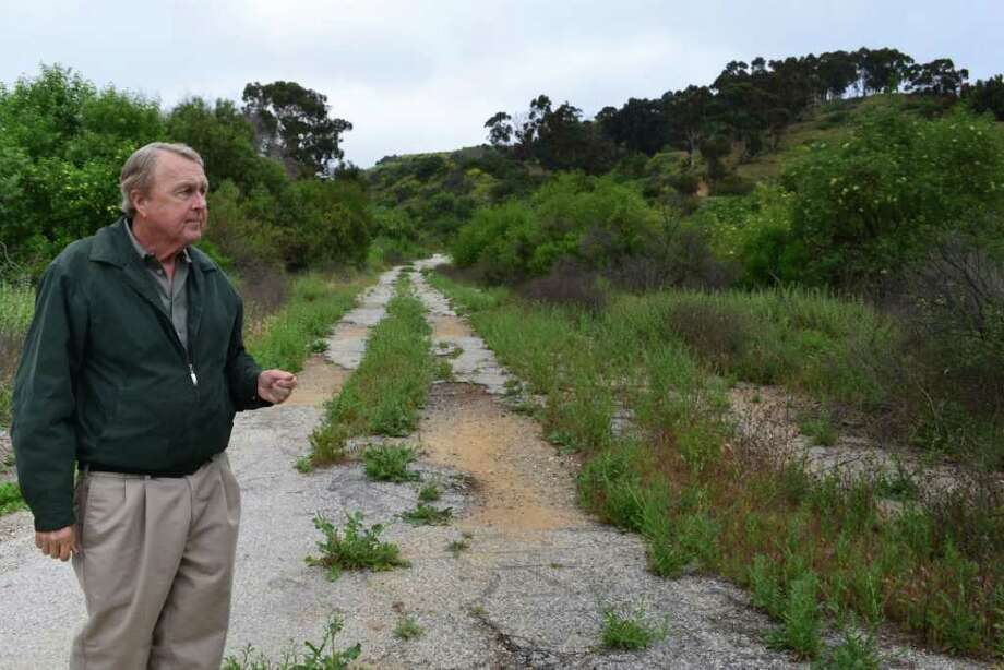 This April 20, 2011 photo shows Whittier, Calif. city official Bob Henderson in Whittier Hills preserve at the proposed well drilling sites in Whittier. As head of the conservation authority, Henderson's responsibility has been to protect the land. But now, with oil hovering around $100 a barrel, the same man who led the charge to save this 1,290 acres is interested in drilling there. (AP Photo/Noaki Schwartz) Photo: Noaki Schwartz, STF / AP