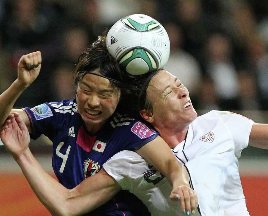 USA's striker Abby Wambach (R) and Japan's defender Saki Kumagai vie for the ball during the FIFA Women's Football World Cup final match Japan vs USA on July 17, 2011 in Frankfurt am Main, western Germany. Japan won 3-1 in a penalty shoot-out after the final had finished 2-2 following extra-time. AFP PHOTO / DANIEL ROLAND (Photo credit should read DANIEL ROLAND/AFP/Getty Images) Photo: DANIEL ROLAND, Stringer / AFP