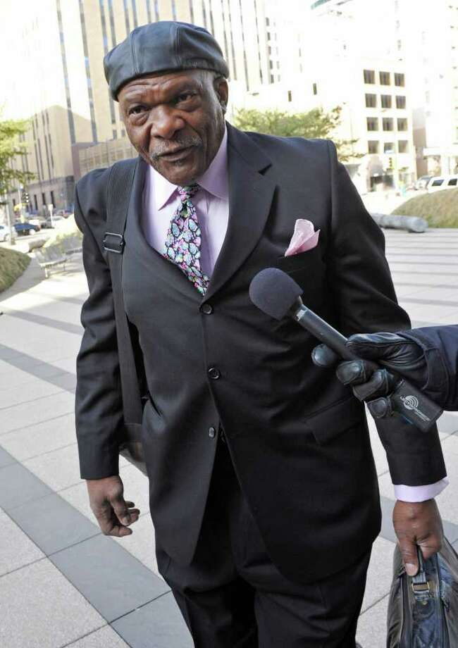 FILE - This April 14, 2011 file photo shows retired Minnesota Vikings Hall of Fame football player Carl Eller, who represents former players, arriving at the federal courthouse in Minneapolis. Eller and lawyers for retired NFL players joined labor talks with representatives of owners and current players,  Tuesday, July 19, 2011 in New York,  as signs mounted that the league's lockout might almost be over. (AP Photo/Jim Mone, File) Photo: Jim Mone, STF / AP2011