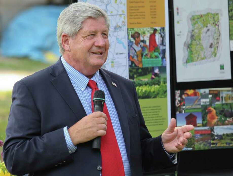 NYS Senator Roy McDonald speaks at the Denison Farm, Schaghticoke, on Tuesday, July 19, 2011. There are currently over 500 enrolled farm share members who received organic vegetables every week from this farm. Owners, Brian and Justine Denison are trying to raise money to ensure that their farm is preserved as farmland for generations to come. (Erin Colligan / Special To The Times Union)