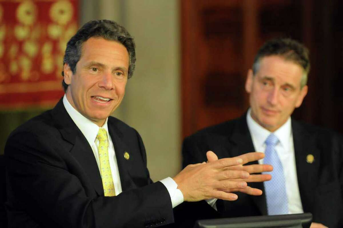 Gov. Andrew Cuomo, left, outlines his plan for New York State during a cabinet meeting on Tuesday, July 19, 2011, at the Capitol in Albany, N.Y. At right is Lt. Gov. Bob Duffy. (Cindy Schultz / Times Union)