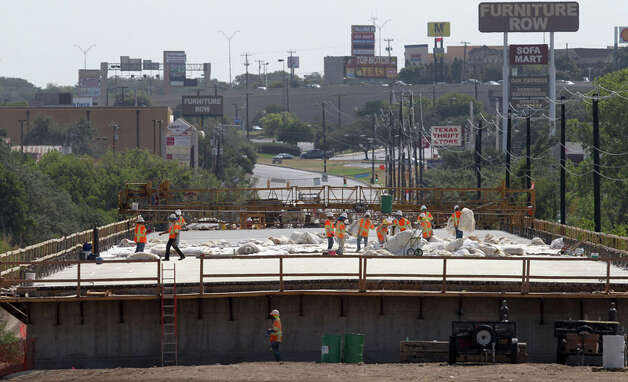 Construction on the new Ingram Road bridge is still in progress and should be open to traffic by November. The 1,716 foot long bridge extends over Leon Creek and Huebner Creek and is approximately 33 feet from the flow line of Leon Creek to the centerline of the roadway. (Tuesday July 19, 2011). (This view is looking towards the east.) JOHN DAVENPORT/jdavenport@express-news.net Photo: JOHN DAVENPORT / jdavenport@express-news.net