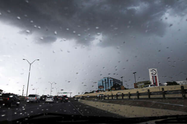 A lightning storm confronts drivers on IH-10 West near Huebner Road during rush hour on July 19, 2011. Photo: TOM REEL / treel@express-news.net