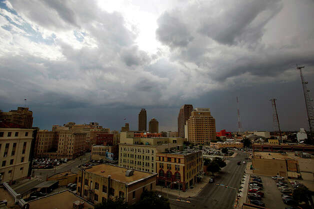 Storm clouds are seen on July 19, 2011, as they roll from the north to the south over downtown San Antonio bringing much-needed rain to the area. San Antonio is experiencing the third worst drought on record, according to the National Weather Service in Austin/San Antonio. Photo: WILLIAM LUTHER / wluther@express-news.net