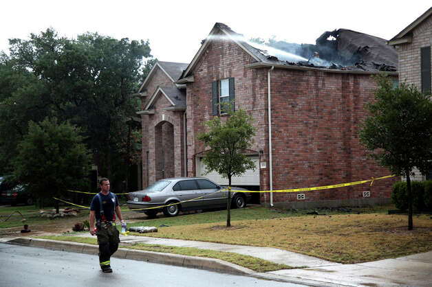 Firefighters respond to a fire caused by lightning near Leon Springs as storms hit the San Antonio area on July 19, 2011. Photo: ANDREW BUCKLEY / abuckley@express-news.net