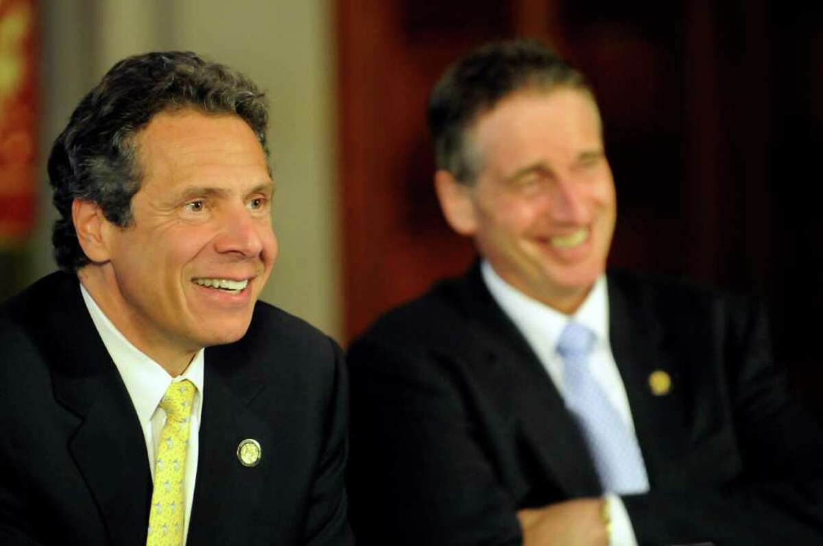 Gov. Andrew Cuomo, left, and Lt. Gov. Bob Duffy share a light moment during a cabinet meeting on Tuesday, July 19, 2011, at the Capitol in Albany, N.Y. (Cindy Schultz / Times Union)