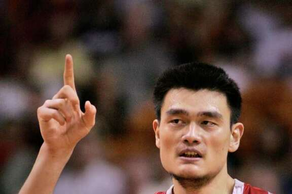 FILE - In this Nov. 12, 2006, file photo, Houston Rockets center Yao Ming, of China, celebrates a basket during the fourth quarter of an NBA basketball game against the Miami Heat in Miami.  Yao has made it official, telling a packed news conference in his hometown Wednesday, July 20, 2011 that a series of injuries have forced him to retire from basketball. (AP Photo/Wilfredo Lee, File)