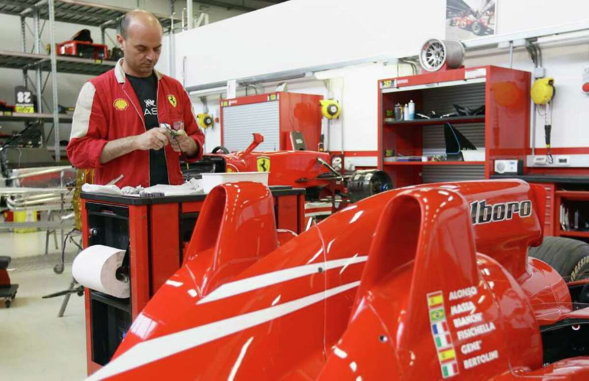 MARANELLO, ITALY - JULY 19: An employee works in the Ferrari Formula 1 clients department during a Ferrari factory tour on July 19, 2011 in Maranello, Italy. Ferrari S.p.A. is an Italian manufacture based in Maranello and founded by Enzo Ferrari in 1929. (Photo by Vittorio Zunino Celotto/Getty Images)