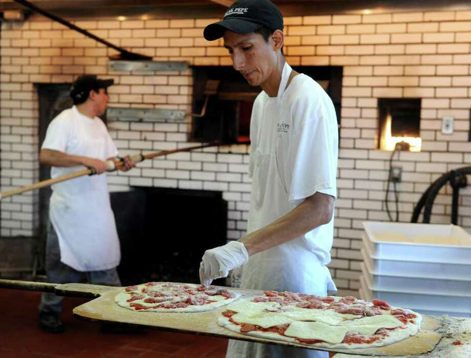 Grab a slice at Pepe's Pizza