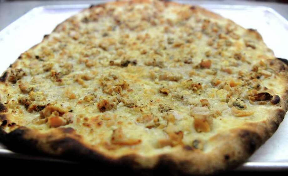People from outside Connecticut may find Frank Pepe's specialty white clam pizza to be odd, but there are plenty of strange pizzas out there. Yahoo Travel found 14 of the most unusual pizza toppings out there. Click through to see some of them and visit Yahoo for the full list. White clam may not seem to weird anymore.  Photo: Lindsay Niegelberg