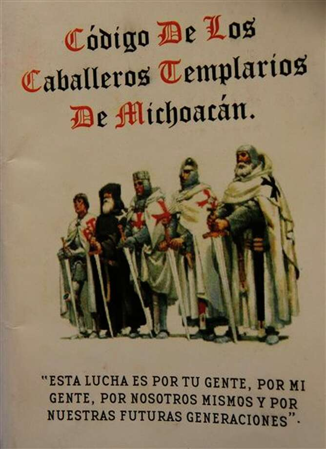 "Photograph of the cover of 'The Code of the Knights Templar of Michoacan',  in Morelia, Mexico, Tuesday, July 19, 2011. The professionally printed, pocket-size booklet was obtained by the Associated Press by a person who did not want to be identified and who said it was distributed earlier this month by two men in regular clothing aboard a bus traveling in rural Michoacan. The sentence at the bottom reads in Spanish: ""This fight is for your people, for my people, for ourselves and for our future generations"". Photo: AP Photo"