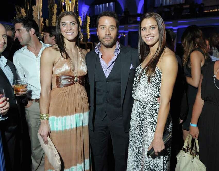 Fresh off their star-making stint at the 2011 World Cup, U.S. Women's Soccer team players Alex Morgan and Hope Solo attended the final season premiere of 'Entourage' in New York City.  They posed with 'Entourage' star Jeremy Piven at the show's premiere.