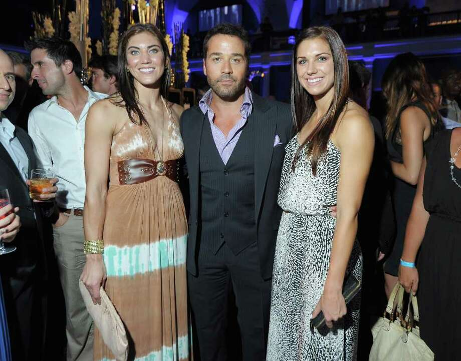 Fresh off their star-making stint at the 2011 World Cup, U.S. Women's  Soccer team players Alex Morgan and Hope Solo attended the final season  premiere of 'Entourage' in New York City. They posed with 'Entourage' star Jeremy Piven at the show's premiere.  Photo: Michael Loccisano, Getty Images / 2011 Michael Loccisano