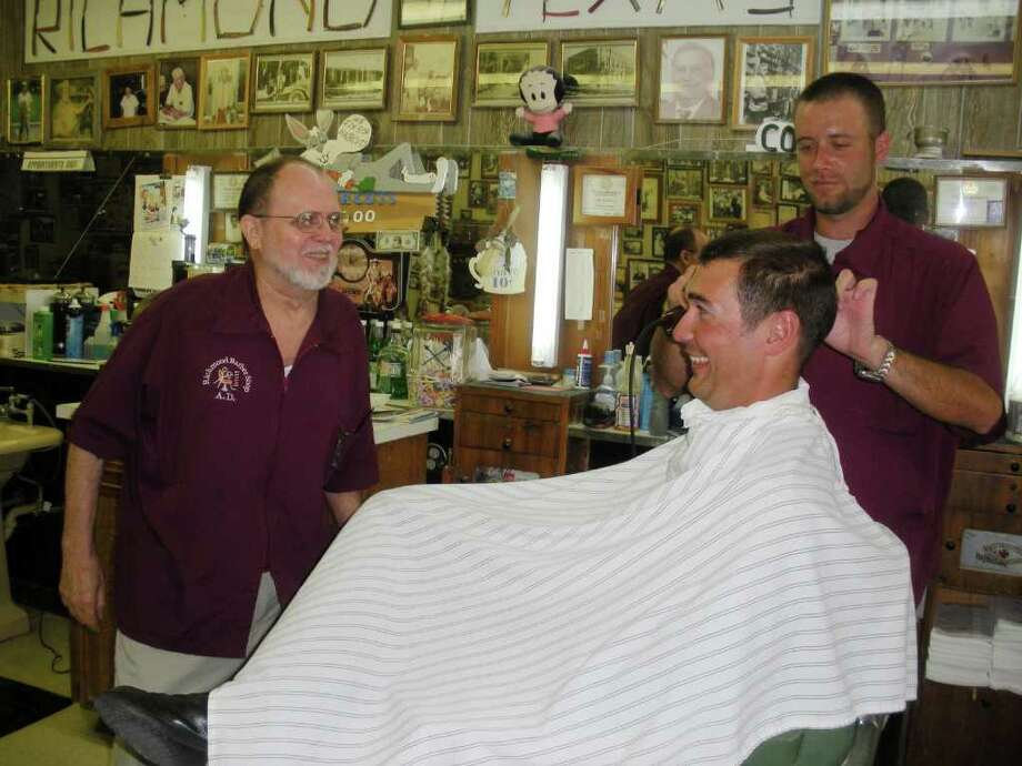 Jeremy Brady gets his hair cut by Colt Eversole at the Richmond Barber Shop. Joking with them is the shop's owner, A.D. Eversole. Photo: B.J. Pollock