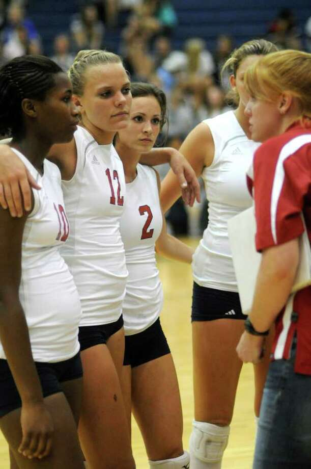Atascocita head coach Jessica Callahan inspires Jeana Daniels, from left, Macie Wyly and Taylor Livoti during a timeout in their match against College Park on Friday. Photo: Jerry Baker, Freelance / Freelance