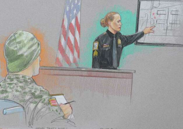 In this courtroom sketch, Officer Kim Munley, right, testifies during the Article 32 hearing for U.S. Major Nidal Hasan, taking notes at left, Wednesday, Oct. 20, 2010 in Fort Hood, Texas. The Article 32 hearing will determine whether Hasan should stand trial on 13 counts of premeditated murder and 32 counts of attempted premeditated murder in the 2009 attack at the Texas Army post, the worst mass shooting at an American military base. Photo: AP