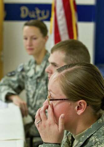 Sgt. Kara Kortenkamp, right, Staff Sgt. Dick Hurtig and Maj. Laura Suttinger, left, all of the 467th Combat Stress Control Detachment, reflect on their return home during a press conference Saturday, Oct. 30, 2010, in Madison, Wis., after returning home from deployment in Afghanistan. Three soldiers were killed in their unit along with 10 others at Fort Hood, in Killleen, Texas, on Nov. 5, 2009, in a shooting rampage by suspect Maj. Nidal Hasan. Photo: AP