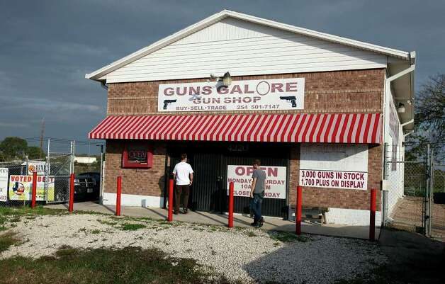 FOR METRO - People enter the Guns Galore Gun Shop where Maj. Nidal Malik Hasan is thought to have purchased the pistols used in the Fort Hood shooting Monday Nov. 9, 2009 in Killeen, Tx. PHOTO BY EDWARD A. ORNELAS/eaornelas@express-news.net) Photo: EDWARD A. ORNELAS, SAN ANTONIO EXPRESS-NEWS / eaornelas@express-news.net