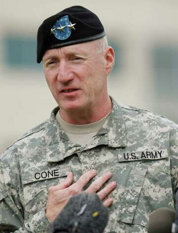 Lt. Gen. Robert Cone gestures during a news conference inside Fort Hood in Killeen, Texas, Monday, Nov. 9, 2009. Army psychiatrist Maj. Nidal Malik Hasan is suspected of opening fire on fellow soldiers during a rampage that left 13 people dead on Thursday, Nov. 5, 2009. President Obama is planning to attend a memorial service at Fort Hood on Tuesday. Photo: AP