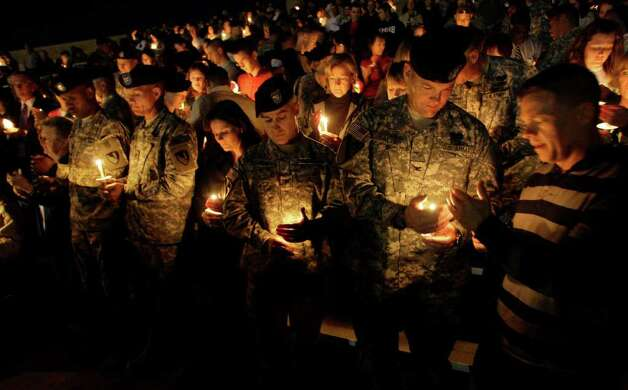 Soldiers hold a candle light vigil at Fort Hood, Texas, Friday, Nov. 6, 2009. Authorities said Maj. Nidal Malik Hasan shot and killed 13 people at Fort Hood, Texas on Thursday. Photo: LM Otero, AP / AP