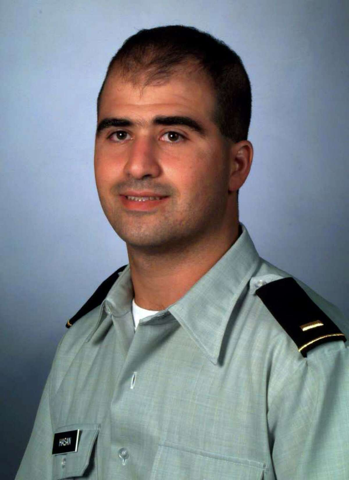 FILE - This 2000 file picture provided by the Uniformed Services University of the Health Sciences (USUHS) shows Nidal Malik Hasan as a medical student at the F. Edward Hebert School of Medicine, USUHS, in Bethesda, Md. According to information gathered during an internal Pentagon review and obtained by The Associated Press, Hasan struggled academically, taking six years to complete the four-year program, but his separate military record was clean enough to get him into Walter Reed for a four-year psychiatry internship and residency.