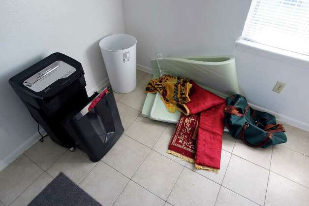 FOR METRO - A paper shredder and pray rugs in the Casa Del Norte apartment where Maj. Nidal Malik Hasan lived Wednesday Nov. 11, 2009 in Killeen, Tx.  (PHOTO BY EDWARD A. ORNELAS/eaornelas@express-news.net) Photo: EDWARD A. ORNELAS, SAN ANTONIO EXPRESS-NEWS / eaornelas@express-news.net