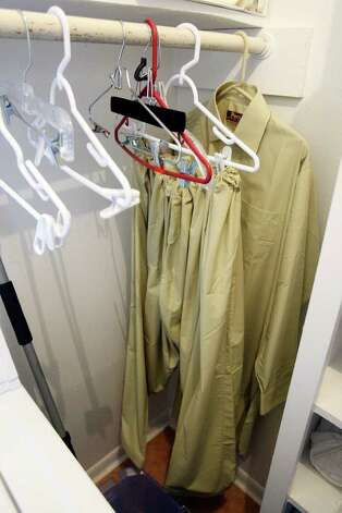 FOR METRO - A salwar kameez hangs in the laundry room in the Casa Del Norte apartment where Maj. Nidal Malik Hasan lived Wednesday Nov. 11, 2009 in Killeen, Tx.  (PHOTO BY EDWARD A. ORNELAS/eaornelas@express-news.net) Photo: EDWARD A. ORNELAS, SAN ANTONIO EXPRESS-NEWS / eaornelas@express-news.net