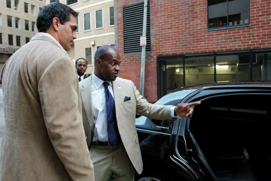 Kevin Mawae, left, president of the NFL Players Association, and DeMaurice Smith, Executive Director, NFL Players Association leave the NFL Players Association offices where talks to end the NFL football lockout have been taking place, Tuesday, July 19, 2011, in Washington. (AP Photo/Jacquelyn Martin) Photo: Jacquelyn Martin, STF / AP