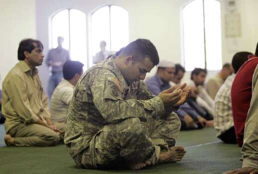 Sgt. Fahad Kamal of Houston, center, prays during Friday prayer services at the Islamic Community of Greater Killeen on Nov. 6, 2009, in Killeen, Texas. Fort Hood shooting suspect Army Maj. Nidal Malik Hasan, attended prayer services at the center before beginning his spree. (AP Photo/The Dallas Morning News, Sonya N. Hebert) **NO SALES, MAGS OUT, TV OUT, INTERNET: AP MEMBERS ONLY** Photo: AP